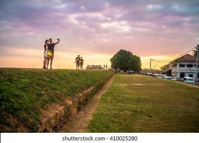 GALLE, SRI LANKA - 23 MARCH 2016: young couple make photo at the fort Galle. Fort was built first in 1588 by the Portuguese, then extensively fortified by the Dutch during the 17th century. Editorial.
