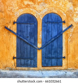 Galle, Sri Lanka - architecture. Blue door on an ancient beige wall