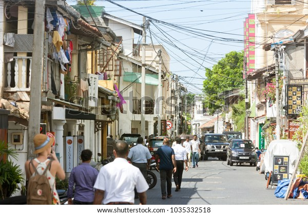 Galle, Sri Lanka, Asia - DECEMBER 2015 - Natives, tourists and cars in the medieval shopping street of Galle