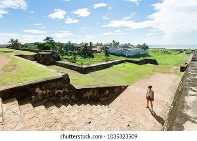 Galle, Sri Lanka, Asia - A woman standing in front of some historical medieval town wall stairs in Galle