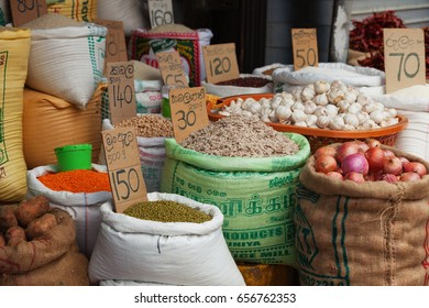 GALLE, SRI LANKA - CIRCA APR 2013: vegetables, grains and spices in bags at the market