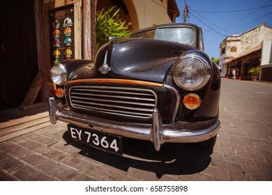 GALLE, SRI LANKA - CIRCA APR 2013: Vintage Black Car Morris Minor 1960s on Galle streets