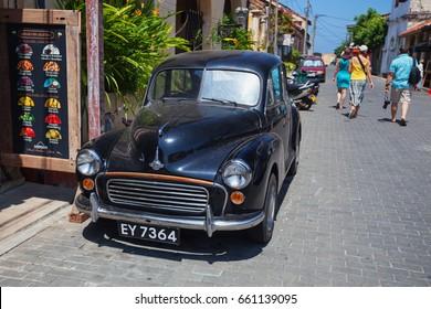 GALLE, SRI LANKA - CIRCA APR 2013: An old black car on the street
