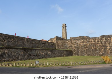 Galle, Sri Lanka - July 29, 2018: The historic Clock Tower and people walking on the city wall