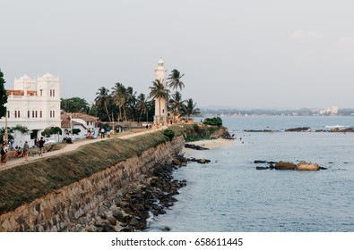 Galle, Sri Lanka, March 22, 2017: White lighthouse and Meeran Jumma Masjid mosque in old Dutch Galle fort, Sri Lanka in sunny day