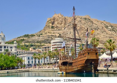 Galleon ship in the Port of Alicante city with the famous landmark, Mount Benacantil in the background.  Alicante, Spain. Europe. July 2018