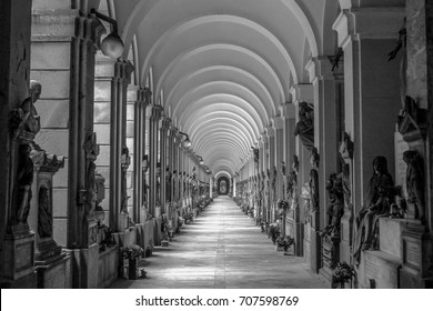 Gallery (corridor) of arches in monumental cemetery (columbarium) and ancient graveyard Staglieno in Genoa, Liguria, Italy. Roman architecture, arcades. Black and white. September, 2014