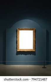 Gallery Interior with empty frame on blue wall