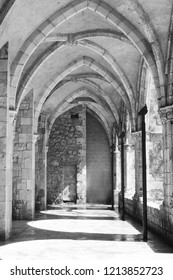 Gallery of monastery with shadows