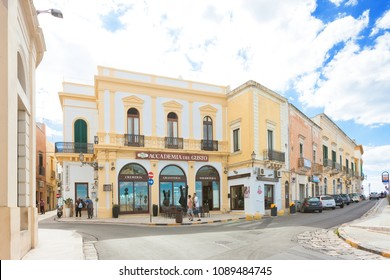 Gallipoli, Apulia, Italy - MAY 2017 - People and shops at the entry of the pedestrian zone of Gallipoli