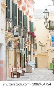 Gallipoli, Apulia, Italy - MAY 2017 - Traditional facades in the pedestrian area of Gallipoli