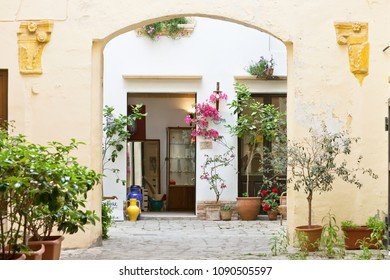 Gallipoli, Apulia, Italy - MAY 2017 - A view into the backyard of a middle aged building