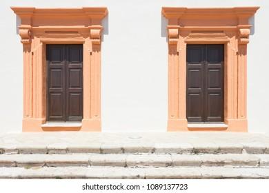 Gallipoli, Apulia, Italy - Two salmon middle aged barn doors
