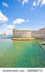 Gallipoli, Apulia, Italy - View across the turquoise water towards the middle aged stronghold