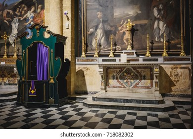 Gallipoli (Italy), August 2017. View of a lateral nave altar with a confession booth in the Sant'Agata Cathedral in the town centre of Gallipoli.