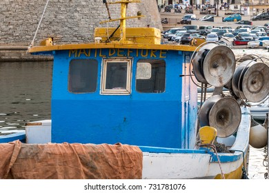 Gallipoli, Lecce - Italy, August 2017 - Fishing boats and nets in Gallipoli, Italy