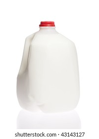 Gallon jug of cold cow milk on white isolated