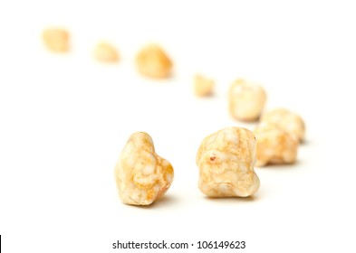 Gallstones removed from a person's gall bladder by surgery on white background