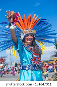 GALLUP , NEW MEXICO - AUGUST 10 :Aztec dancer with traditional costume participates at the 92 annual Inter-tribal ceremonial parade on August 10 , 2013 in Gallup New-Mexico