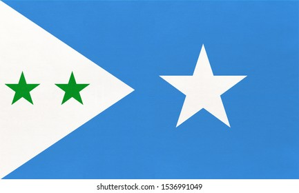 Galmudug national fabric flag, textile background. Symbol of international world African country. State official Somali sign.