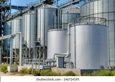 Galvanised Iron grain silos on a farm in Eastern Europe