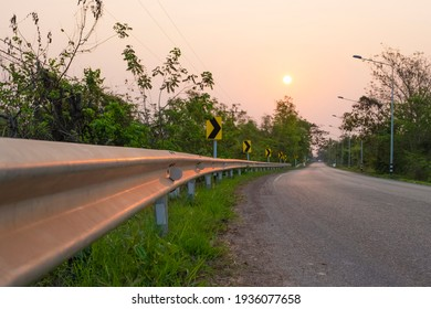 galvanized guardrail beside road for safety traffic on road.