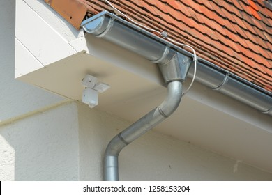 Galvanized Rain Gutter, Rainwater Pipe and Connector Nozzle at tiled Roof