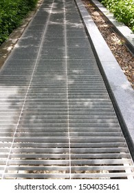 Galvanized steel grating sheet isolated on waterspout background. Exterior design and Copy space concept.
