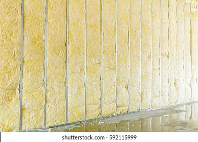 Galvanized steel joist is holding thermal insulation material, rock wool.