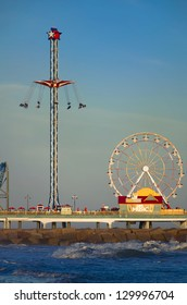 Galveston Pleasure Pier captured at dusk on a sunny day