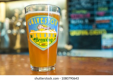 GALVESTON, TEXAS - CIRCA OCTOBER 2017: A cold foamy beer is enjoyed in a pint glass at the Galveston Island Brewery in Galveston, Texas.