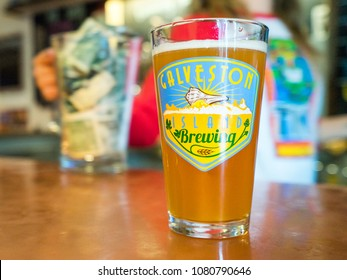 GALVESTON, TEXAS - CIRCA OCTOBER 2017: A cold foamy beer is enjoyed in a pint glass at the Galveston Island Brewery in Galveston, Texas.