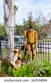 GALVESTON, TEXAS, JANUARY 2017: Many trees were killed during hurricane Ike in 2008, and artists have carved sculptures into remaining stumps; this one is Tin Man from The Wizard of Oz by Jim Phillips