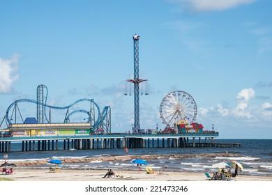 GALVESTON, TEXAS - SEPT 10, 2014: Historic Pleasure Pier amusement park and beach on the Gulf of Mexico coast in Galveston, Texas.