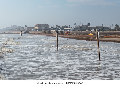 Galveston, Texas; United States: January 5th 2017: view of the wavy ocean and the beach