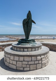 GALVESTON, TEXAS, USA - JULY 11, 2013: Bronze sculpture with dolphins on the waterfront of the Gulf of Mexico in Galveston.