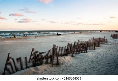 Galveston, TX, US - August 17, 2018: View of Galveston Beach at sunset Galveston Island Texas.