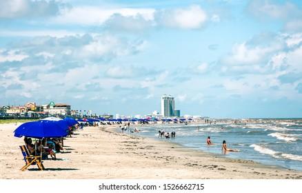 Galveston, TX, US - August 17, 2019: View of  purple beach umbrellas on Galveston Island Texas.