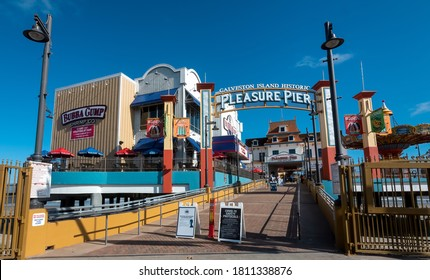 Galveston, TX, US - August 29, 2020: View of  the Pleasure Pier  amusement park with COVID=19 regulation signs on Galveston Island Texas