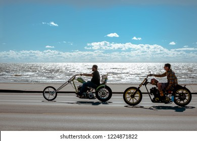 Galveston, TX, US - Nov 03, 2018: Bikers cruise along the Seawall in Galveston during the Lone Star Rally in Galveston Texas.