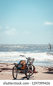 Galveston, TX, US - Oct 06, 2018: Adult trike with surfboard rack on Seawall in Galveston Texas.