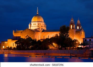 Galway Cathedral illuminated at night, View From The Corrib River, Ireland