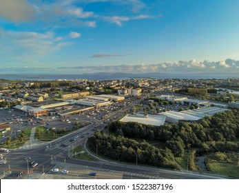 Galway city / Ireland - 09/22/2019: Aerial view, Headford road, Shopping centers, cloudy sky.
