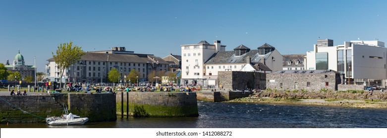 GALWAY CITY, IRELAND - 5th May, 2018: Panorama of Galway city at the mouth of the Corrib river, View of Galway Cathedral in the distance.