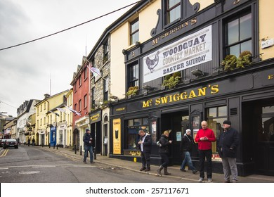 GALWAY CITY, IRELAND - MARCH 31, 2013:  Street scene by an Irish pub in the medieval city of Galway, Ireland.