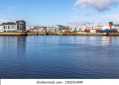 Galway harbour, Corrib river and Galway buildings with reflection, Galway, Ireland
