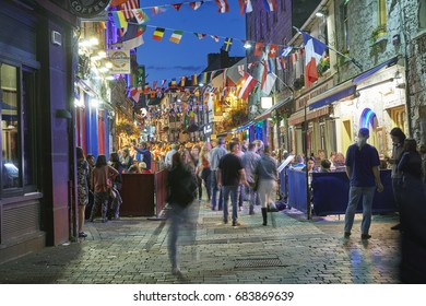 GALWAY IRELAND - 23RD JULY 2017; Vibrant cafe and bar culture in the city centre of Galway illuminated at night