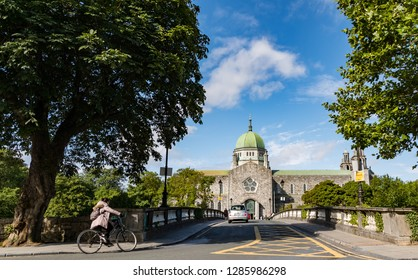 Galway, Ireland - 29th July, 2018: Bridge crossing over towards Galway Cathedral in the city of Galway, Republic of Ireland