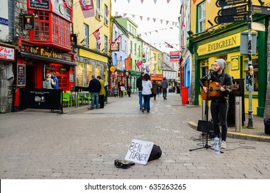 GALWAY, IRELAND. 4th APRIL, 2017: local musician playing at galway street