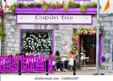 GALWAY, IRELAND - JULY 11, 2018: Exterior of a tea house with colorful display and violet frames in Galway, Ireland